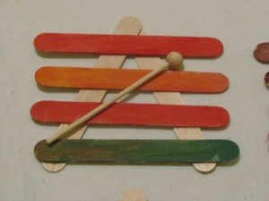 Making craft stick xylophones in preschool