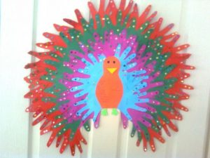 handprint peacock bulletin board idea for kids