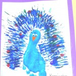 A peacock made with a footprint, painting with a fork