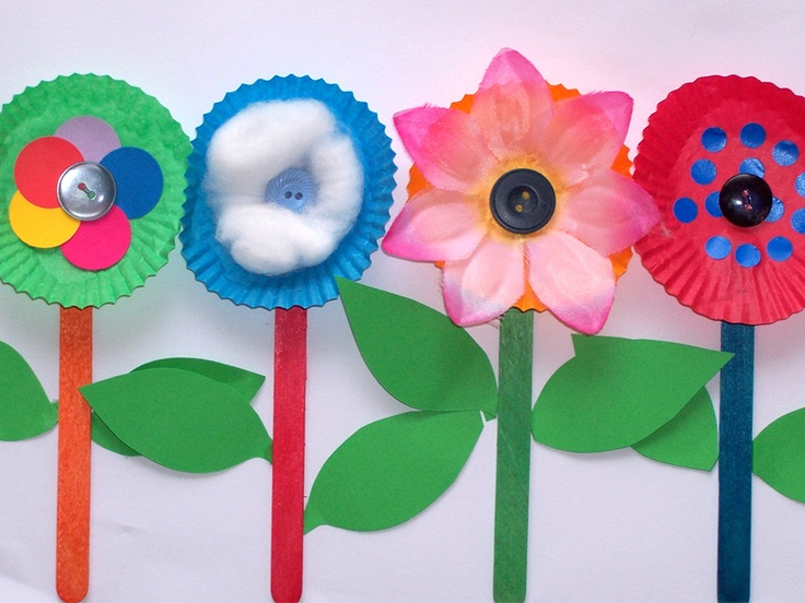 flower cupcake mold cups, buttons, and popsicle sticks.
